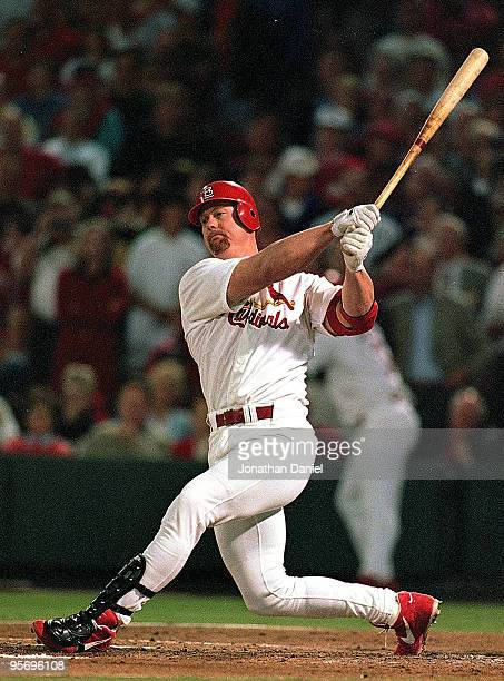 Mark McGwire of the St Louis Cardinals hits the ball during the game against the Houston Astros at Busch Stadium in St Louis Missouri According to...