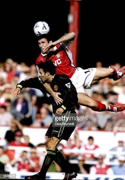 Martin Keown of Arsenal rises above Ryan Giggs of Arsenal during the FA Carling Premiership match at Highbury in London Arsenal won 30 Mandatory...