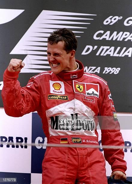 Michael Schumacher of Germany celebrates a Ferrari win after the Italian Grand Prix at Monza, Italy. \ Mandatory Credit: Michael Cooper /Allsport
