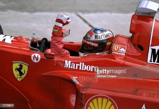 Michael Schumacher of Germany celebrates a Ferrari win after the Italian Grand Prix at Monza Italy Mandatory Credit Michael Cooper /Allsport