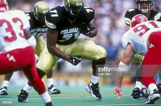 Offensive tackle Victor Rogers of the Colorado Buffaloes in action during a game against the Fresno State Bulldogs at the Folsom Field in Boulder...