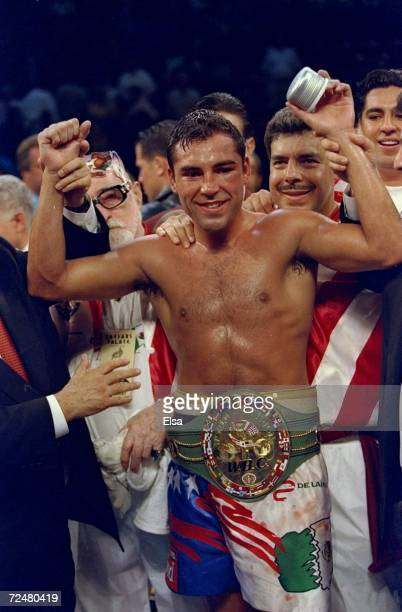 Oscar De La Hoya celebrates his 8th round TKO victory over Julio Cesar Chavez during their bout at the Thomas and Mack Center in Las Vegas Nevada...
