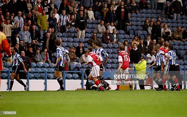Paolo Di Canio of Sheffield Wednesday after he pushes referee Paul Alcock to the ground during the FA Carling Premiership match against Arsenal at...