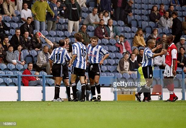 Paolo Di Canio of Sheffield Wednesday is sent off by Paul Alcock the referee during the FA Carling Premiership match against Arsenal at Hillsborough...