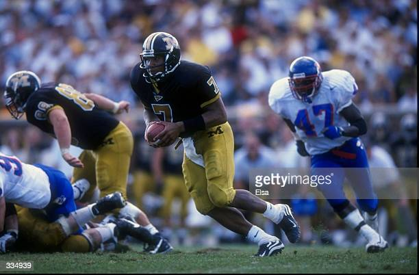 Quarterback Corby Jones of the Missouri Tigers in action against linebacker Patrick Brown of the Kansas Jayhawks during a game at Faurot Field in...