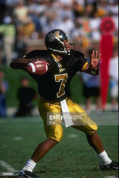 Quarterback Corby Jones of the Missouri Tigers steps back to throw during the game against the Kansas Jayhawks at Faurot Field in Columbia, Missouri....