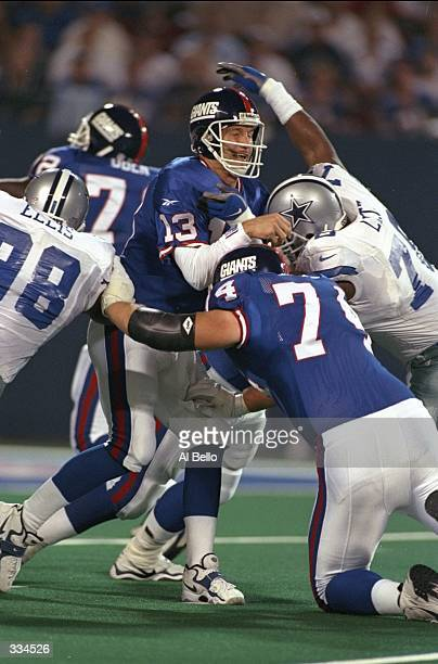 Quarterback Danny Kanell for the New York Giants gets sacked during the game against the Dallas Cowboys at Giant Stadium in East Rutherford New York...