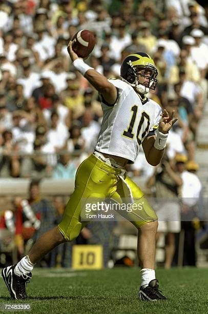 Quarterback Tom Brady of the Michigan Wolverines throws a pass during a game against the Notre Dame Fighting Irish at the Notre Dame Stadium in South...