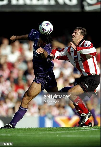 Ramon Vega of Tottenham Hotspur heads away from Matt Le Tissier of Southampton during the FA Carling Premiership match at the Dell in Southampton...