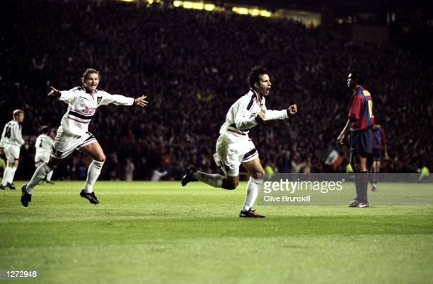 Ryan Giggs of Manchester United celebrates a goal during the Champions League match against Barcelona at Old Trafford in Manchester England The game...