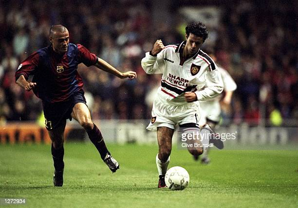 Ryan Giggs of Manchester United in action during the Champions League match against Barcelona at Old Trafford in Manchester England The game ended in...