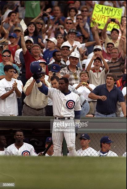 Sammy Sosa of the Chicago Cubs hits his 62nd home run during the game against the Milwaukee Brewers at Wrigley Field in Chicago Illinois The Cubs...