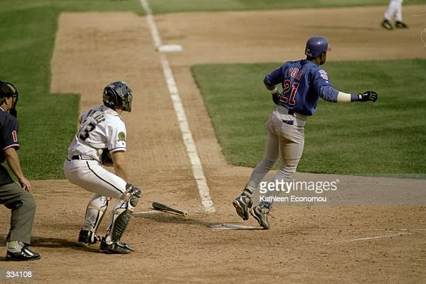 Sammy Sosa of the Chicago Cubs watches after hitting his 65th home run of the year in the sixth inning during a game against the Milwaukee Brewers at...