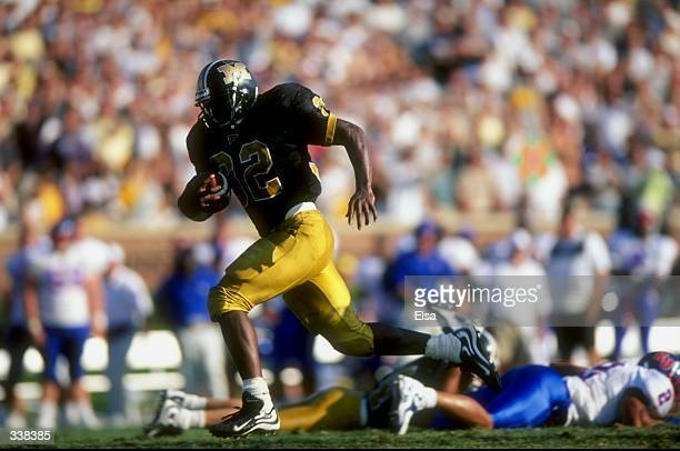 Tailback Devin West of the Missouri Tigers in action during a game against the Kansas Jayhawks at Faurot Field in Columbia, Missouri. The Tigers...