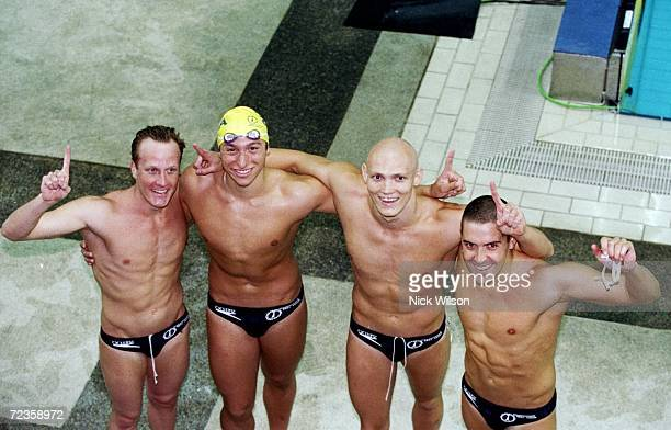 The Australian 4x200m Freestyle team Daniel Kowalski Ian Thorpe Michael Klim and Matthew Dunn win gold with a New World Record during the 1998...