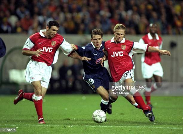 Vladimir Smicer of Lens is closed down by Emmanuel Petit and Martin Keown of Arsenal during the UEFA Cup Winners Cup against Arsenal at Felix...