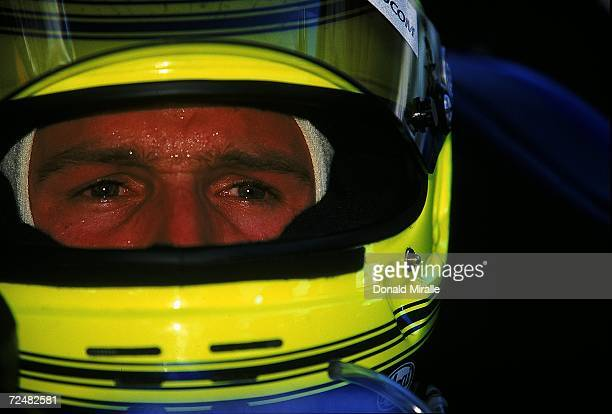 A close up of driver Cristiano da Matta of Brazil who drives the Toyota Reynard 99I for MCI/ArcieroWells Racing is looking on during practice for the...