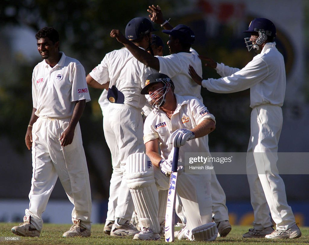 A dejected Shane Warne of Australia stands up as the Sri Lankans celebrate his run out, during day two of the First Test between Sri Lanka and Australia at Asgiriya Stadium, Kandy, Sri Lanka. Mandatory Credit: Hamish Blair/ALLSPORT