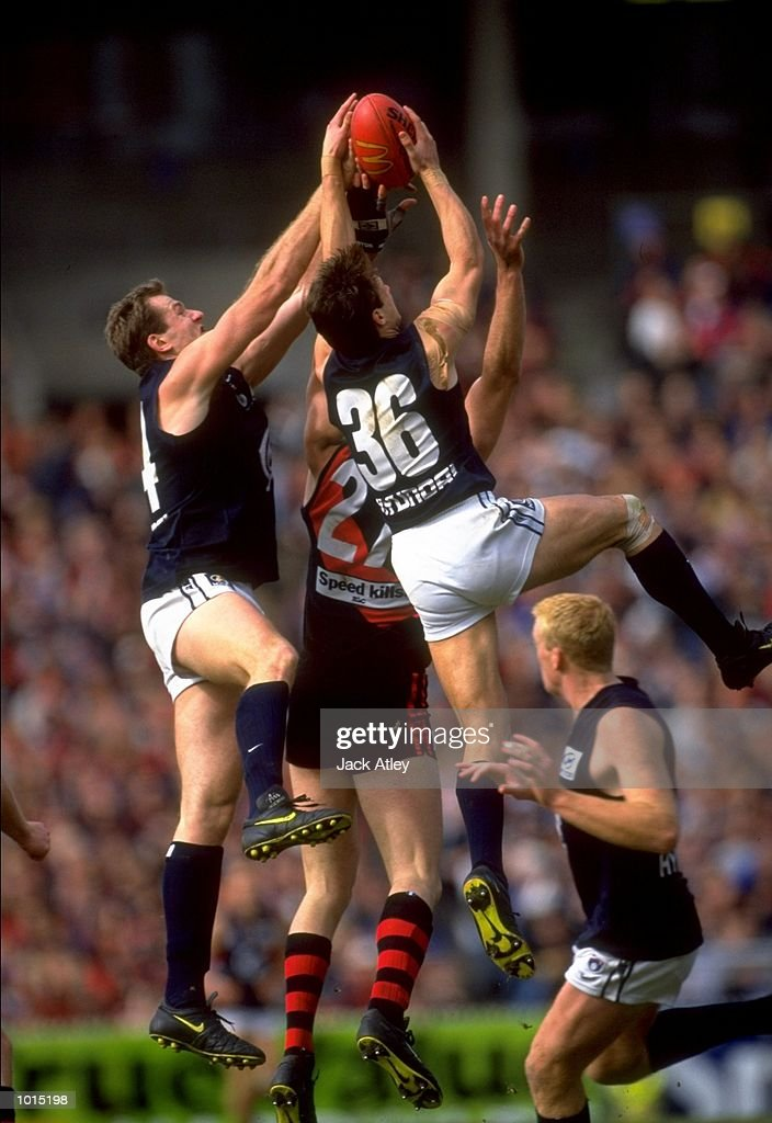 Aaron Hamill #36 of the Carlton Blues soars to take the mark during the AFL Second Preliminary Final against the Essendon Bombers at the MCG in Melbourne, Australia. Carlton progressed to the Grand Final with a tense 104 - 103 win. \ Mandatory Credit: Jack Atley /Allsport