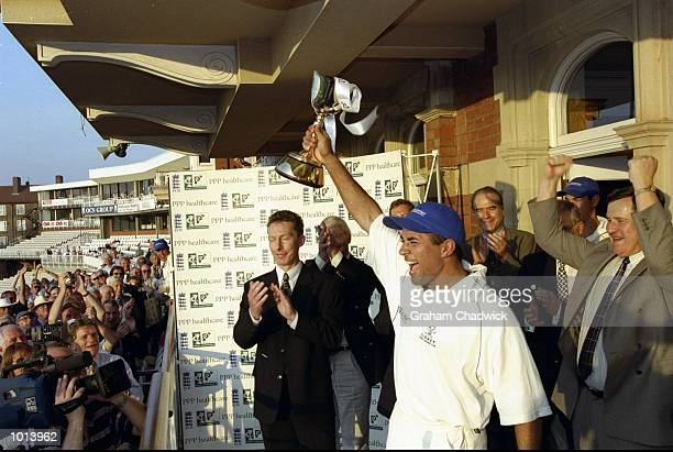 Adam Hollioake of Surrey holds the trophy after winning the PPP Healthcare City Championships against Nottinghamshire played at the Oval in London,...