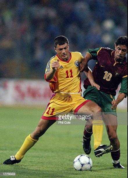 Adrian Ilie of Romania holds off Rui Costa of Portugal during the European Championship qualifier at the Steaua Stadium in Bucharest Romania The game...
