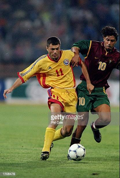 Adrian Ilie of Romania takes on Rui Costa of Portugal during the Euro 2000 qualifier at the Steaua Stadium in Bucharest Romania Mandatory Credit Phil...