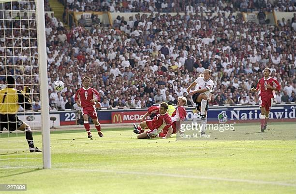 Alan Shearer of England scores his second goal during the Euro 2000 qualifying match between England and Luxembourg played at Wembley Stadium in...