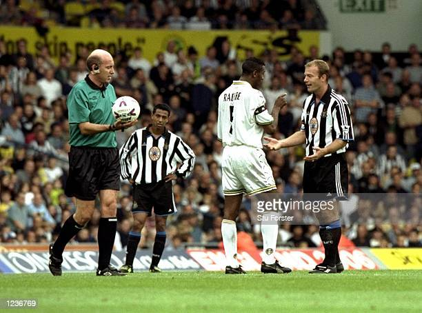 Alan Shearer of Newcastle argues with Lucas Radebe of Leeds during the FA Carling Premiership match played at Elland Road in Leeds England Leeds won...