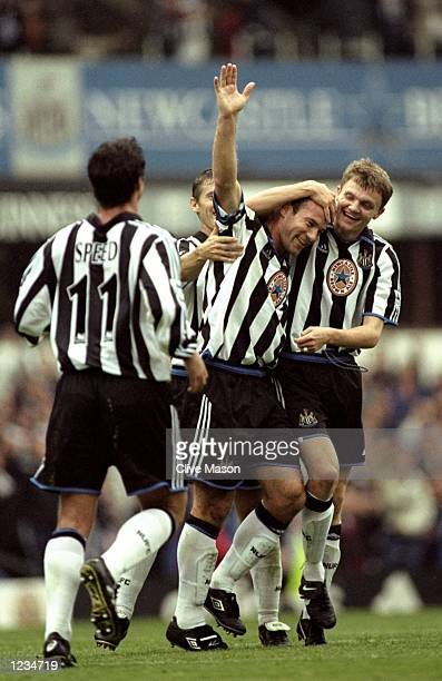 Alan Shearer of Newcastle is congratulated by team-mates during the Newcastle United v Sheffield Wednesday FA Carling Premier League match played at...