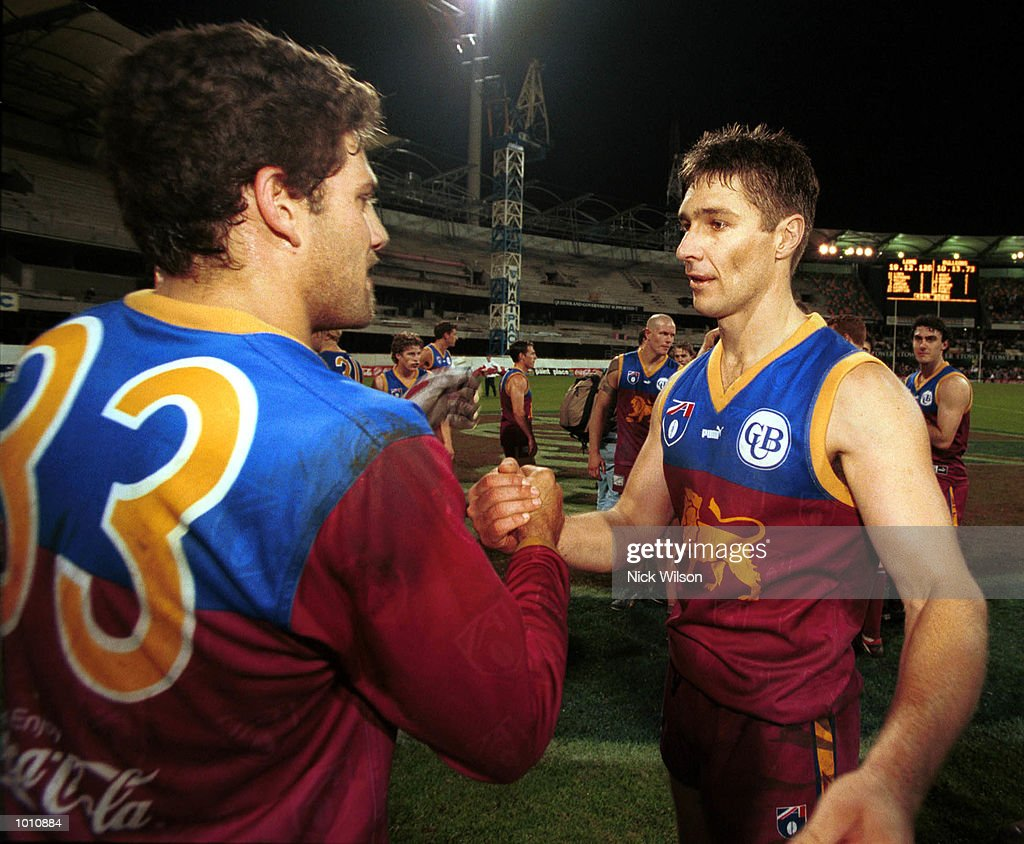 Alastair Lynch #11 and Darryl White #33 of Brisbane congratulate each other after winning the 2nd semi final between the Brisbane Lions and the Western Bulldogs at the Gabba, Brisbane, Australia. Mandatory Credit: Nick Wilson/ALLSPORT