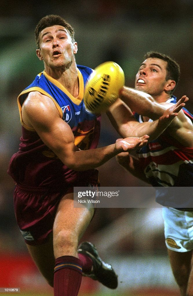 Alastair Lynch #11 of the Brisbane Lions juggles the ball during the 2nd semi final between the Brisbane Lions and the Western Bulldogs at the Gabba, Brisbane, Australia. Mandatory Credit: Nick Wilson/ALLSPORT