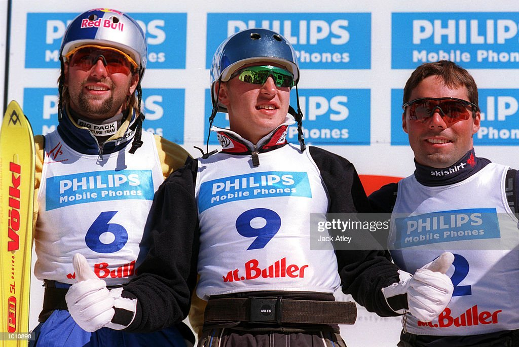 Ales Valenta of the Czech Republic, (left) who finished in second place, Alexei Grichin of Belarus (centre) who finished first and Nicolas Fontaine of Canada (right) who finished in third place, salute the crowd following the second roundof the 1999/2000 world cup aerials season, at Mount Buller, Australia. Mandatory Credit: Jack Atley/ALLSPORT