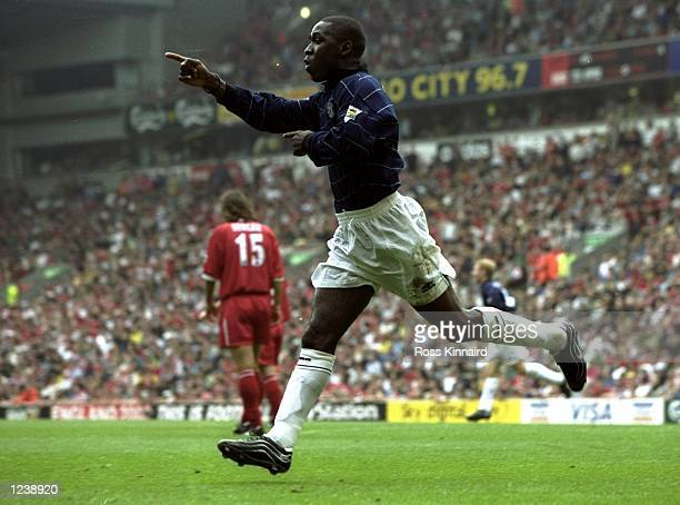 Andy Cole of Manchester United celebrates after scoring United's second goal during the Premiership match between Liverpool and Manchester United...