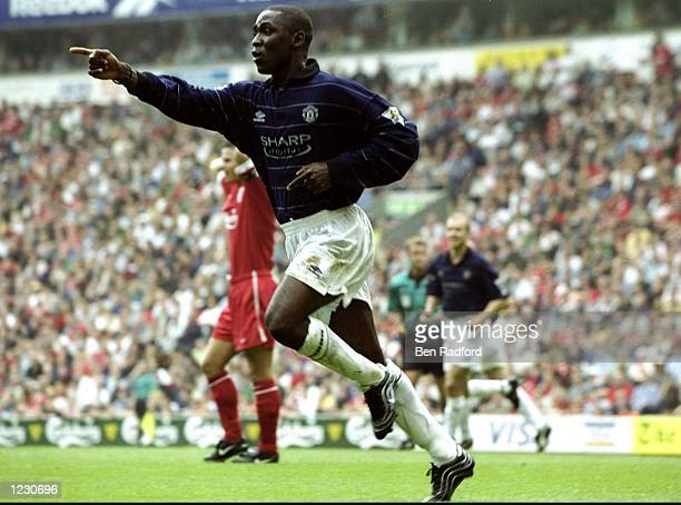 Andy Cole of Manchester United celebrates his goal against Liverpool during the FA Carling Premiership match at Anfield in Liverpool England United...