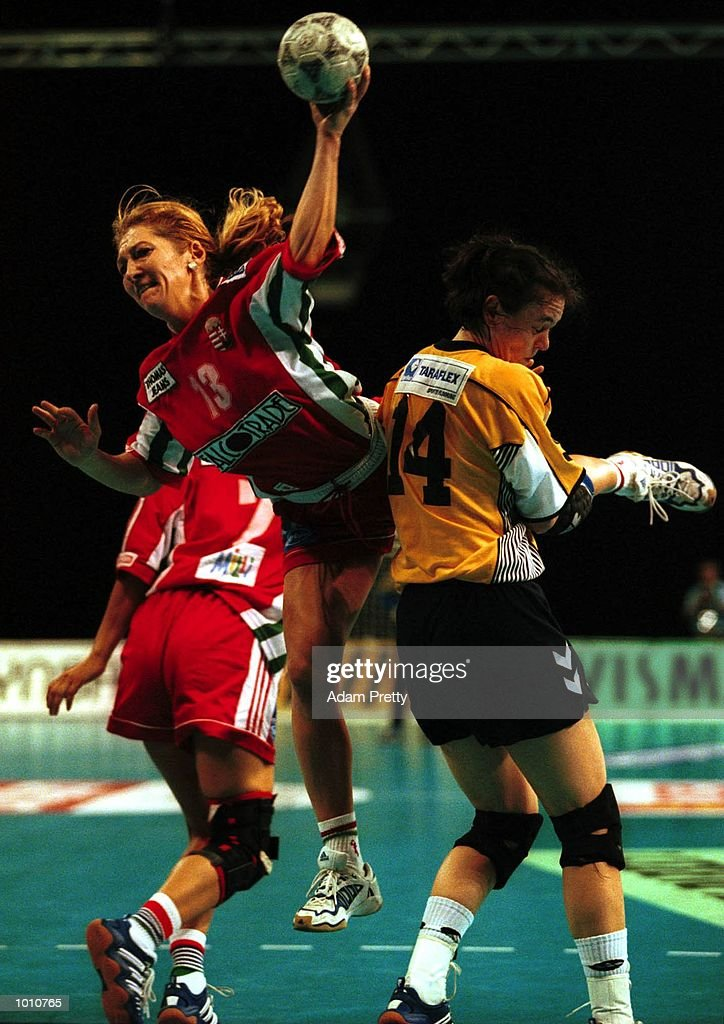 Aniko Kantor of Hungary dives over Lydia Kahmke of Australia for a shot at goal during the match between Australia v Hungary at the Southern Cross International Handball Challenge, at the Buring Pavilion, Sydney Olympic Park Homebush, SydneyAustralia. Mandatory Credit: Adam Pretty/ALLSPORT