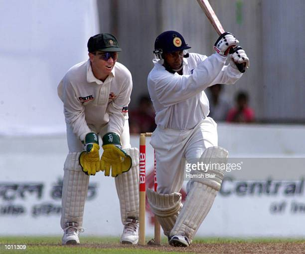 Arivinda de Silva of Sri Lanka on the attack with Ian Healy of Australia looking on during day one of the second test between Sri Lanka and Australia...