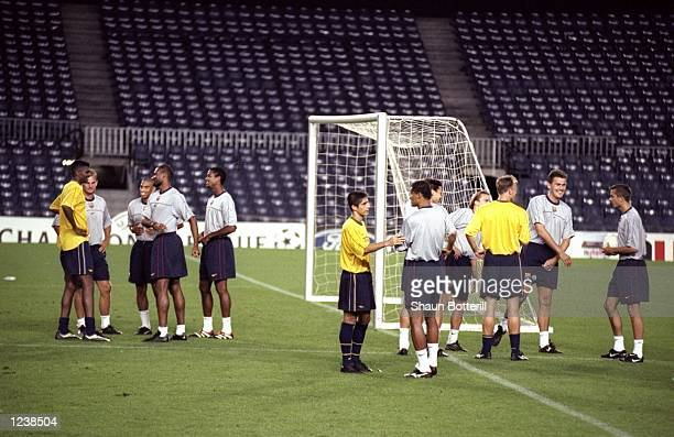 Arsenal and Barcelona players chat in groups during a training session prior to the Barcelona v Arsenal UEFA Champions League Group B match played at...