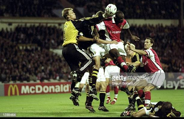 Arsenal attackers cause problems for Solna's keeper Mattias Asper during the UEFA Champions League match between Arsenal v AIK Solna played at...