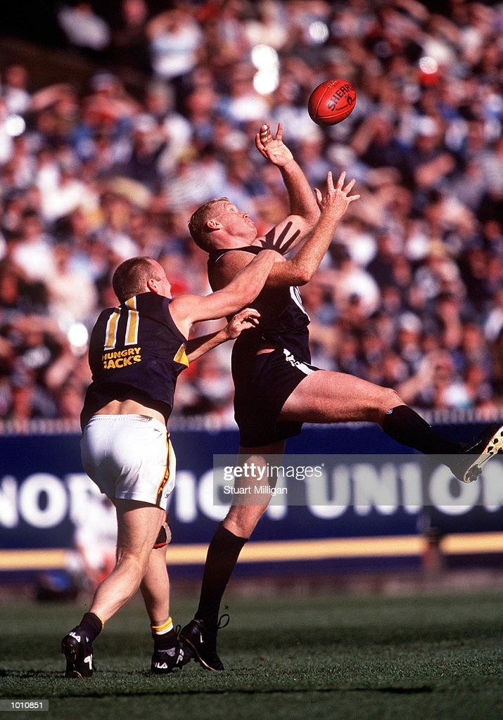 Ashley McIntosh #11 for the West Coast Eagles attempts to spoil Lance Whitnall #8 for Carlton , during the first semi final played at the MCG, Melbourne, Victoria, Australia. Carlton eliminated West Coast from the finals series. Mandatory Credit: Stuart Milligan/ALLSPORT