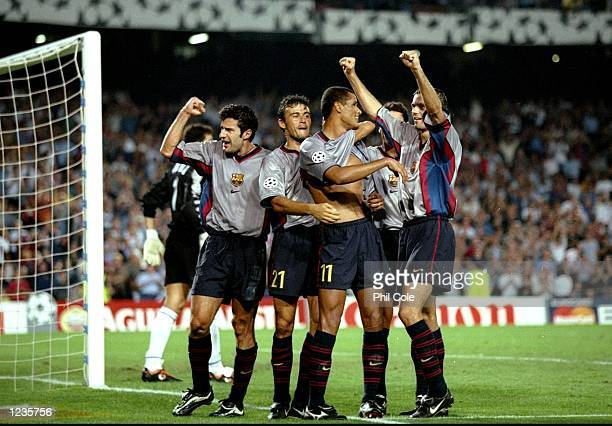 Barcelona celebrate Rivaldo's goal against Fiorentina during the UEFA Champions League group B match at the Nou Camp in Barcelona Spain Barcelona won...