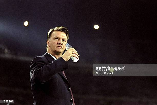 Barcelona coach Louis van Gaal watches his team in action during the Barcelona v Arsenal UEFA Champions League Group B match played at the Nou Camp...