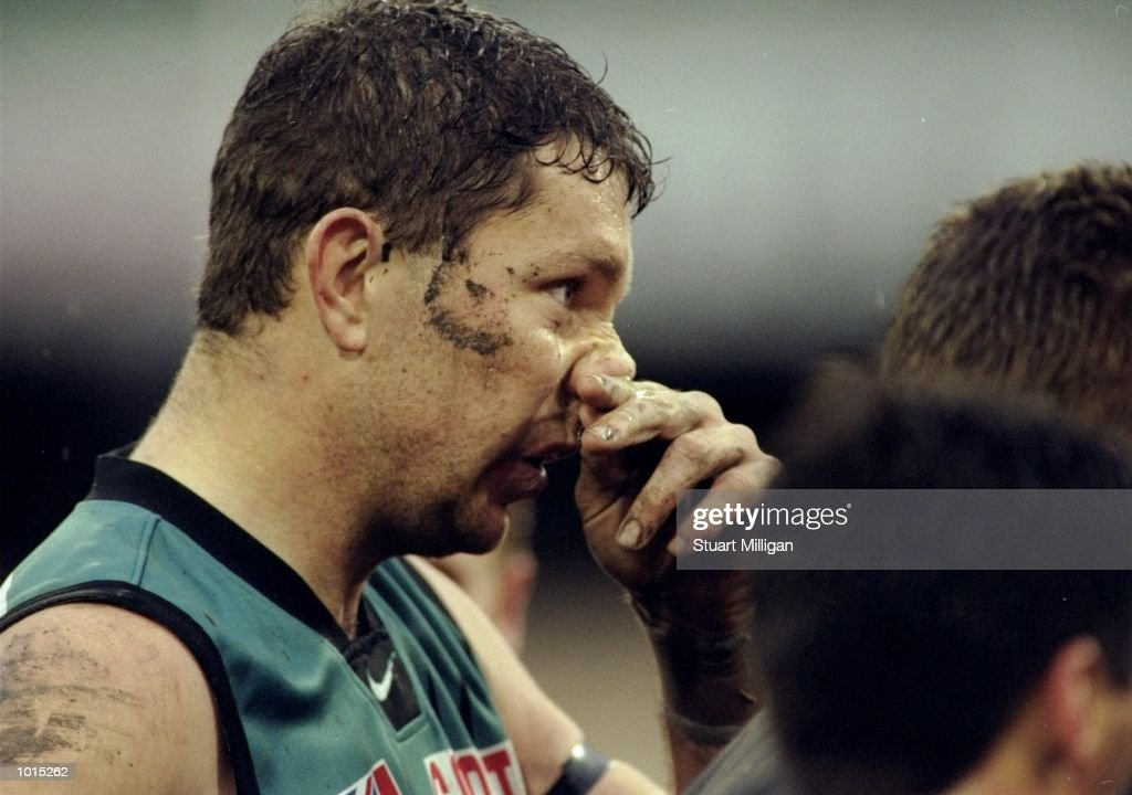 Brendon Lade of Port Adelaide listens to the team talk during the AFL Third Qualifying Final against the Melbourne Kangaroos at the MCG in Melbourne, Australia. The Kangaroos progressed to the latter stages winning by 100 - 56. \ Mandatory Credit: Stuart Milligan /Allsport