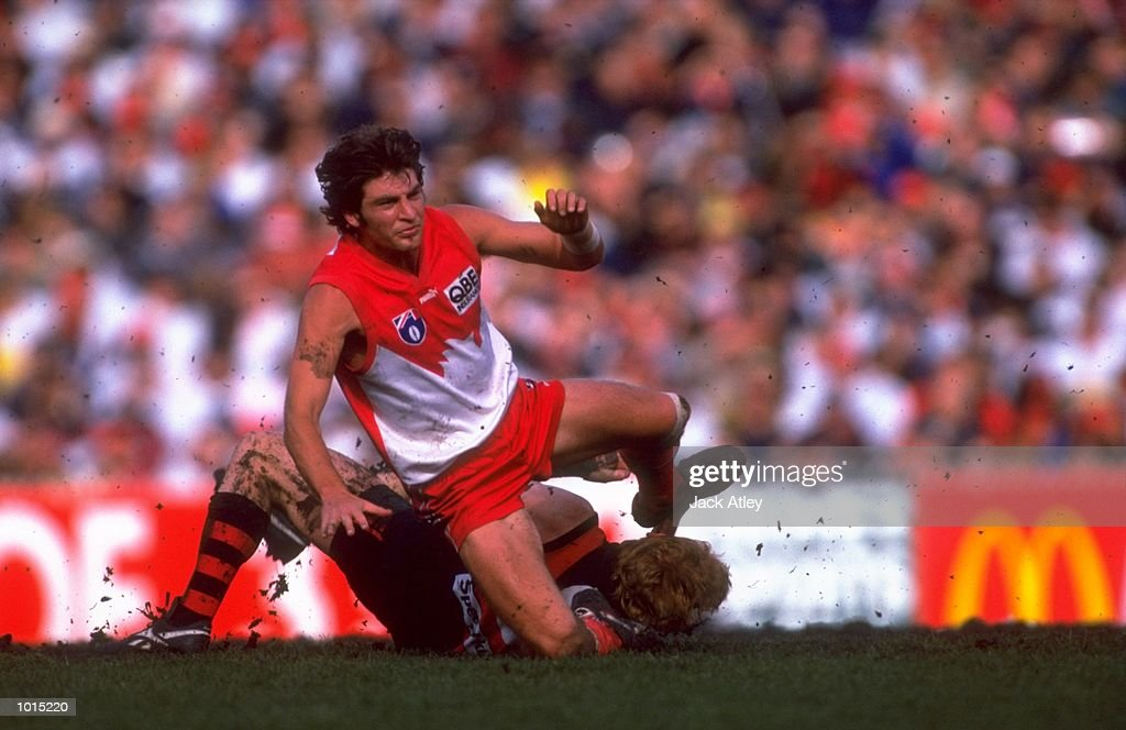 Brett Kirk of the Sydney Swans battles with Darren Bewick of the Essendon Bombers during the AFL Fourth Qualifying Final at the MCG in Melbourne, Australia. The Bombers progressed to the latter stages with a convincing 123 - 54 win. \ Mandatory Credit: Jack Atley /Allsport