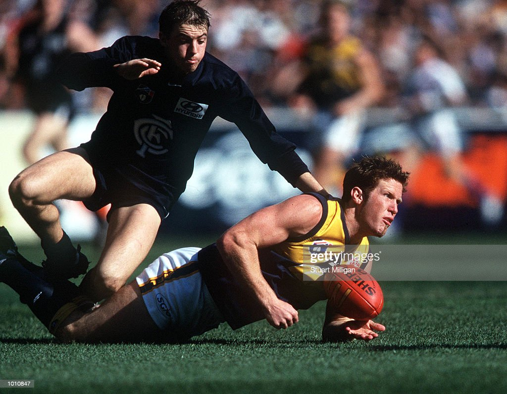 Chad Morrison #5 for the West Coast Eagles gets a handpass away as Matthew Lappin #12 for Carlton tackles him, during the first semi final played at the MCG, Melbourne, Victoria, Australia. Carlton eliminated West Coast from the finals series. Mandatory Credit: Stuart Milligan/ALLSPORT
