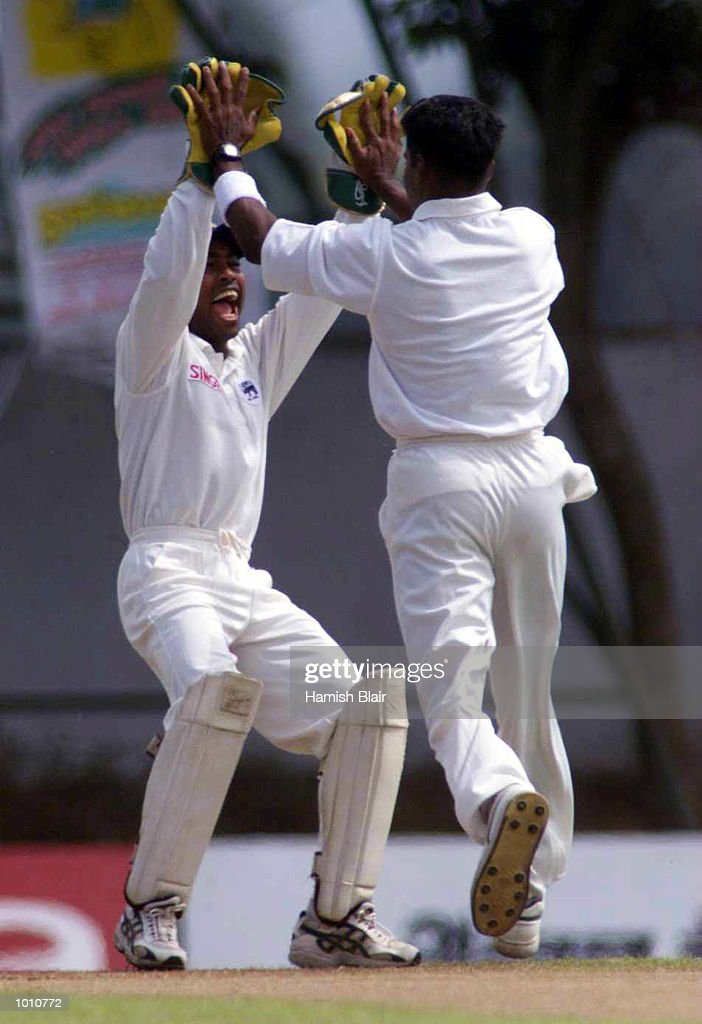 Chaminda Vaas (right) and Romesh Kaluwitharana of Sri Lanka celebrate after Vass trapped Michael Slater of Australia LBW for a duck, during day one of the First Test between Sri Lanka and Australia at Asgiriya Stadium, Kandy, Sri Lanka. Mandatory Credit: Hamish Blair/ALLSPORT