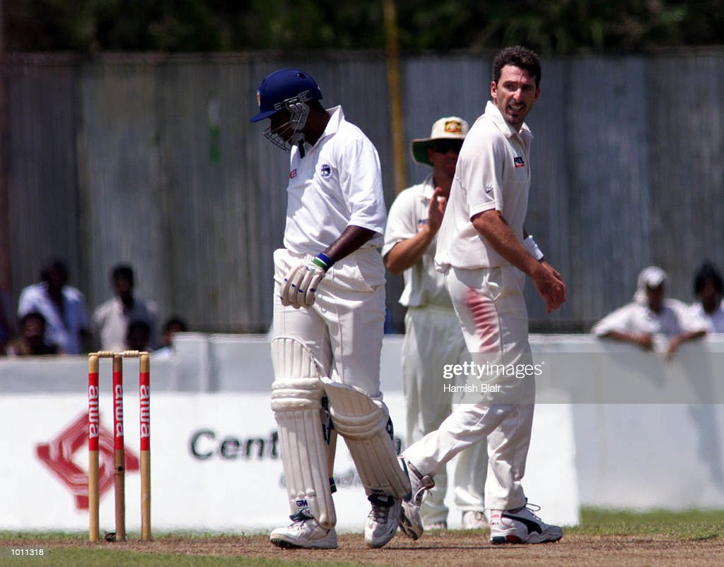 Chaminda Vaas of Sri Lanka and Damien Fleming of Australia, physically clash and exchange words after Fleming dismissed Vaas, during day two of the second test between Sri Lanka and Australia at Galle International Stadium, Galle, Sri Lanka.X Mandatory Credit: Hamish Blair/ALLSPORT
