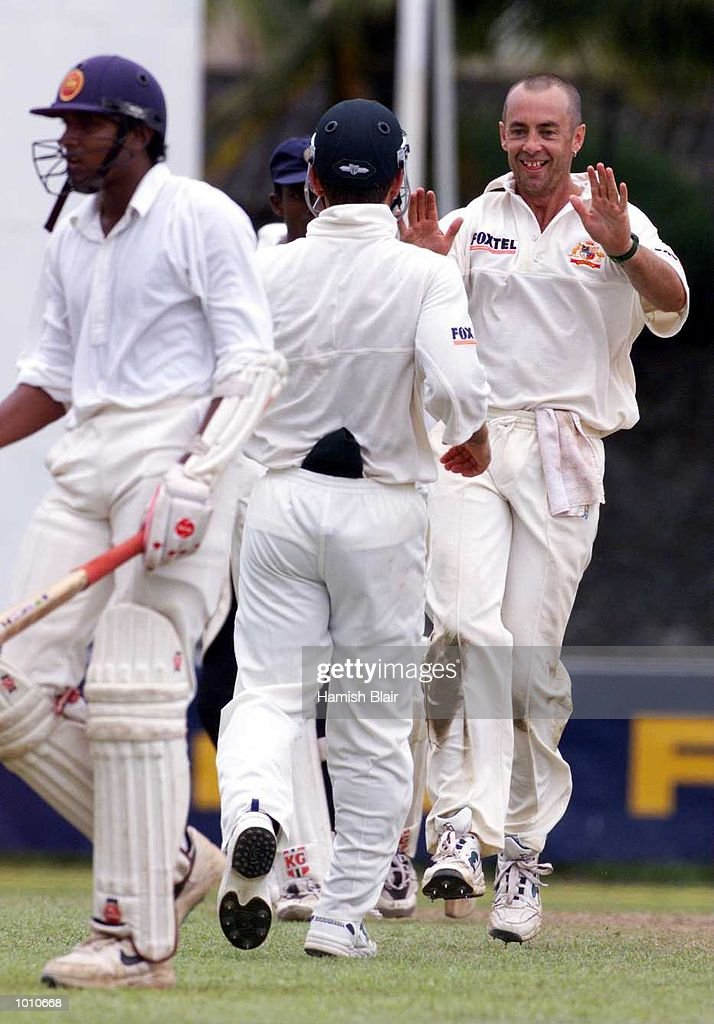 Colin Miller (right) of Australia celebrates with Justin Langer after Pradeep Hewage of the Board XI (left) was out caught by Justin Langer off the bowling of Colin Miller, during day three of the tour match between the Sri Lanka Board XI and Australia at Saravanamuttu Stadium, Colombo, Sri Lanka. Mandatory Credit: Hamish Blair/ALLSPORT