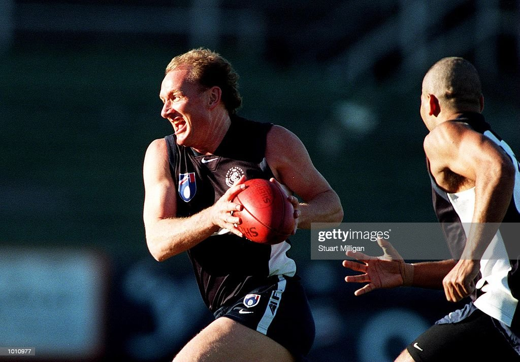 Craig Bradley,#21 for Carlton runs with the ball as teammate Justin Murphy,#18 attempts to catch him during A..F.L training at Optus Oval, Melbourne, Australia. Mandatory Credit: Stuart Milligan/ALLSPORT