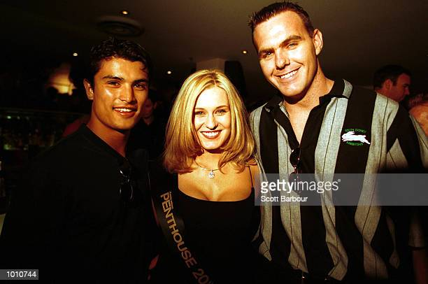 Craig Wing and Paul McNicholas of South Sydney pose with Natasha Zuvela 1999 Australian Penthouse pet of the year during the announcement of the...