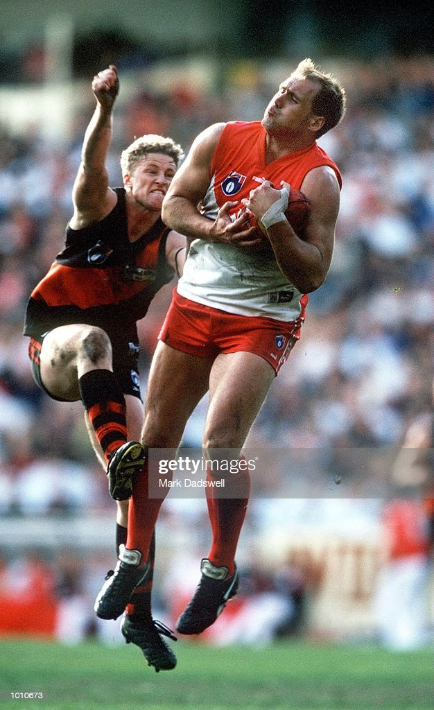 Damian Hardwick #11 for Essendon fails to spoil Tony Lockett #4 for Sydney during the fourth qualifying final played at the MCG, Melbourne, Victoria, Australia. The match, which was Lockett's last AFL game, was won easily by Essendon. Mandatory Credit: Mark Dadswell/ALLSPORT